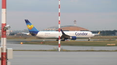 Airplanes at Frankfurt airport. Dusk Stock Footage
