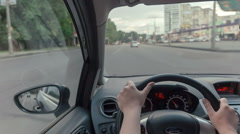 Pov woman driving car throw street with trafic Stock Footage