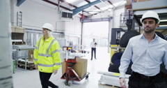 4K Male forklift truck driver arrives on shift in a factory or warehouse Stock Footage