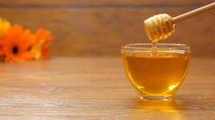 Honey in a beautiful glass bowl. Honeyspoon dipped in honey (No 9.3) Stock Footage