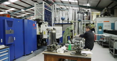 4K Machine operator working on metalwork machine in a factory Stock Footage