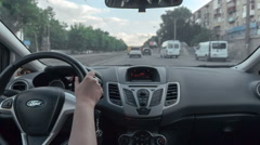 Back seat POV view driving car throw street with trafic Stock Footage
