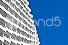 Rows of many white balconies of a modern building Stock Photos