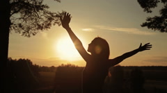 Silhouette of woman in the forest on the sunset. Freedom concept. Stock Footage