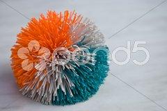 Fuzzy ball in orange Stock Photos