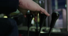 4K Close up on hand unrecognizable industrial worker changing gear in forklift Stock Footage