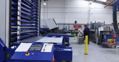 4K Time lapse of busy team of factory workers operating machinery Stock Footage