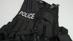 Picking up tactical vest for police Stock Footage