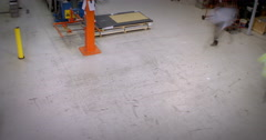 4K Time lapse of busy warehouse workers lifting and moving empty pallets Stock Footage