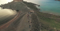 Aerial Shot over tourists climbing up a hill Stock Footage