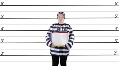 Prisoner with whiteboard in lineup Stock Footage