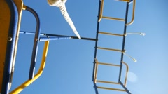 Teeter rope bottom view of video rock against the blue sky Stock Footage