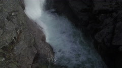Rising High Above Epic Rocks and Mountain Waterfall Stock Footage