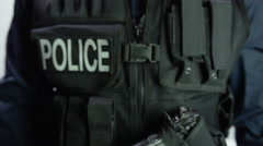 Police holding body camera Stock Footage