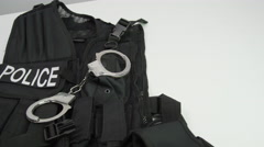 Police tactical vest and handcuffs Stock Footage