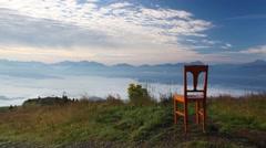 Old wooden chair on the top in Gerlitzen Alps. Stock Footage