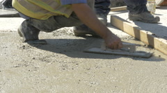 Worker using trowel and leveling concrete at building construction by Sheyno. Stock Footage