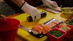 Sliceing sushi roll Stock Footage