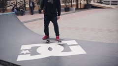 Skateboarder ride on springboard on street in city. Skatepark. People. Sport Stock Footage