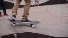Skateboarder ride on springboards on street in city. Girl. Training. Falling Stock Footage