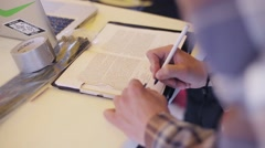 Person signature in book with printed letters by pen on table. Adhesive tape Stock Footage