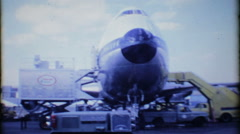 Lufthansa 747 passenger airliner at loading gate 3560 -vintage film home movie Stock Footage