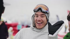 Skiers and snowboarders in encamp on ski resort. Smile, wave hands in camera Stock Footage
