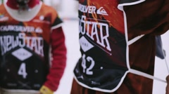 Snowboarders and skiers in encamp on ski resort before contest. Mountains Stock Footage