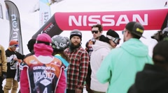 Snowboarders and skiers in encamp on ski resort. Contest. Mountains. Uniform Stock Footage