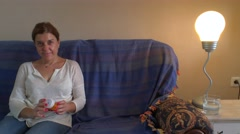 Middle aged couple sitting on the sofa of House discussed the medical treatment Stock Footage