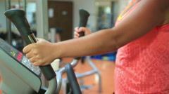 Woman trains on stepper machine in gym. Concept of health and fitness. 2 Stock Footage