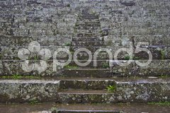 Steps leading up in between the rows of seats of an antic theater Stock Photos