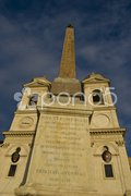 Obelisk and church on top of the spanish steps in Rome Stock Photos