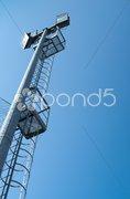 Small stadium reflector on a blue sky Stock Photos