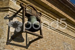 Old bell hanging from a church wall Kuvituskuvat