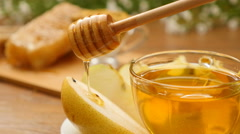 Honey pouring on pear from the honeyspoon (No 11.5) Stock Footage