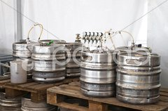 Steel indutrial barrels of beer stocked in storage Stock Photos