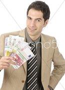 Geschäftsmann mit Geldbündel Stock Photos