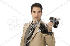 Geschäftsmann hebt eine Hantel Stock Photos