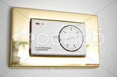 High precision thermostat on a white wall Stock Photos