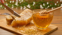 Composition of honey and honeycomb. Сut a piece of honeycomb (No 12.2) Stock Footage