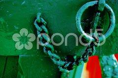 Closeup of an old green iron chain Stock Photos