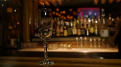 Pour a glass of champagne - slow motion  Stock Footage