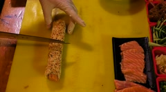 Shef Sliceing sushi roll Stock Footage