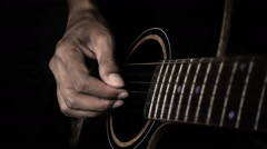 Super slow motion man playing guitar in dark tone Stock Footage
