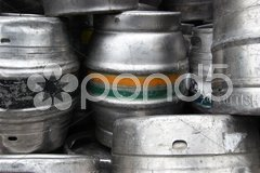 Beer barrels stacked on the the pavement in front of a bar Stock Photos