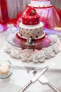 Figurines on bottom of wedding cake Stock Photos
