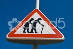 Traffic sign for paying attention for elderly people Stock Photos