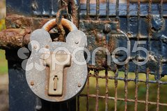 Old rusty lock on a wooden gate Stock Photos