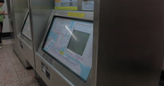 Woman using self-service machine in Hong Kong subway Stock Footage